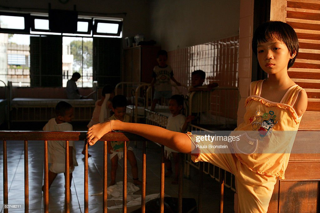 Pham Thi Thuy Linh, 11 years old, stands in a door way at the Tu Du Hospital May 2, 2005 in Ho Chi Minh City, Vietnam. She has been deformed since birth from what may be the effects of the defoliant Agent Orange used in the Vietnam War. On March 10 a U.S. Federal Court in Brooklyn, New York dismissed a law suit on behalf of millions of Vietnamese against the U.S. for its use of the toxic defoliant during the Vietnam War, which contains dioxin. In 1984, seven American chemical companies paid $180 million to settle a suit by U.S veterans affected by Agent Orange. Vietnam pledges to pursue the lawsuit and is taking the case to a US Court of Appeals in June.