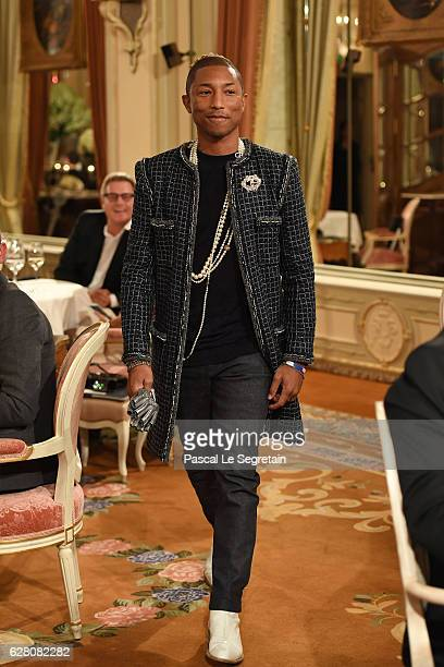 Pharell Williams walks the runway during 'Chanel Collection des Metiers d'Art 2016/17 Paris Cosmopolite' show on December 6 2016 in Paris France