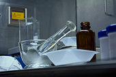 Pharmaceutical compounding equipment, including a glass pestle and mortar ready for use.