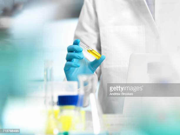 Pharmaceutical Research, doctor preparing a medicine phial for a medical trial
