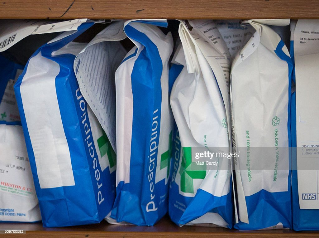 Pharmaceuticals and prescriptions awaiting collection are seen inside a independent chemist shop are seen on February 12, 2016 in Bath, England. One in four high street pharmacies could close as the Government cuts £170 million from the prescription handling fees paid to them.