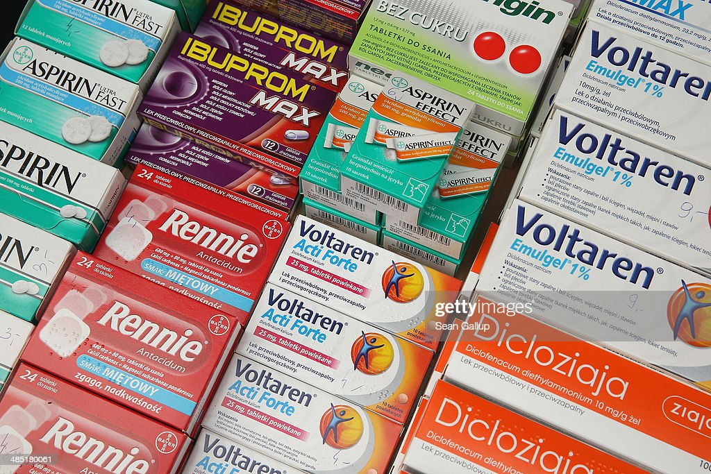 Pharmaceuticals including aspirin and antacids that are cheaper than their equivalents in Germany lie on a counter for sale at an outdoor market near...
