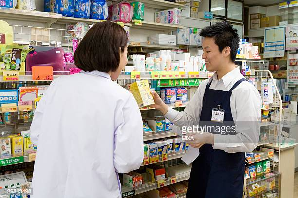 Pharmacist and Clerk of Drugstore Talking