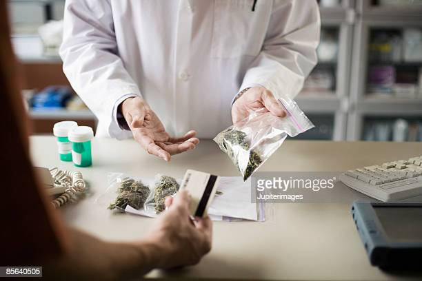 Pharmacist and customer with medical marijuana