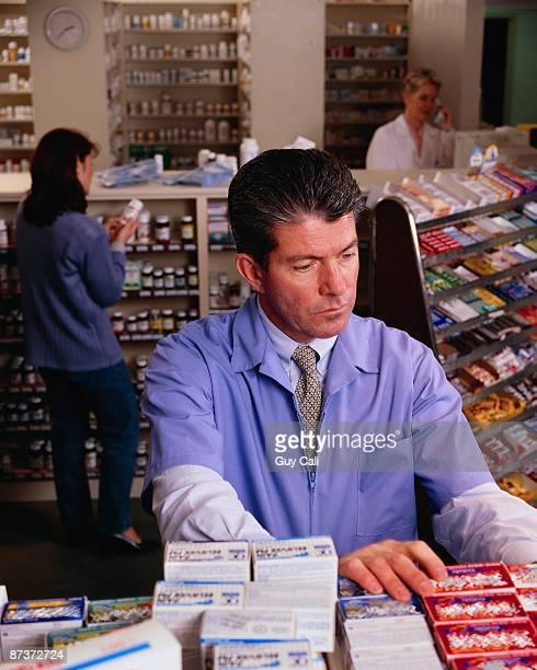 Pharmacist at Drug Shelves