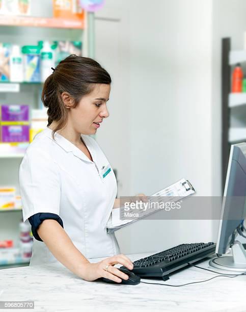 Pharmacist checking prescriptions