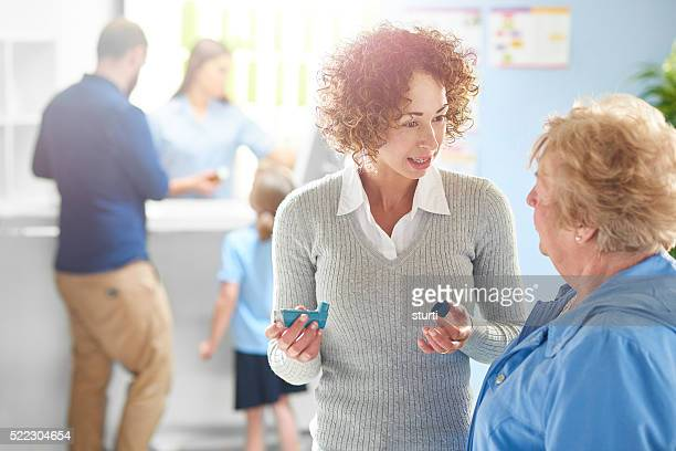 pharmacist explains to asthmatic customer