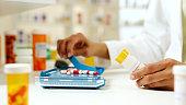 Pharmacist filling Prescription