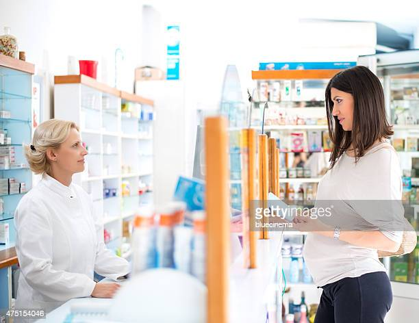 Pharmacist giving lotion to a customer