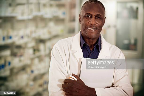 Pharmacist Holding Clipboard and Pill Bottle