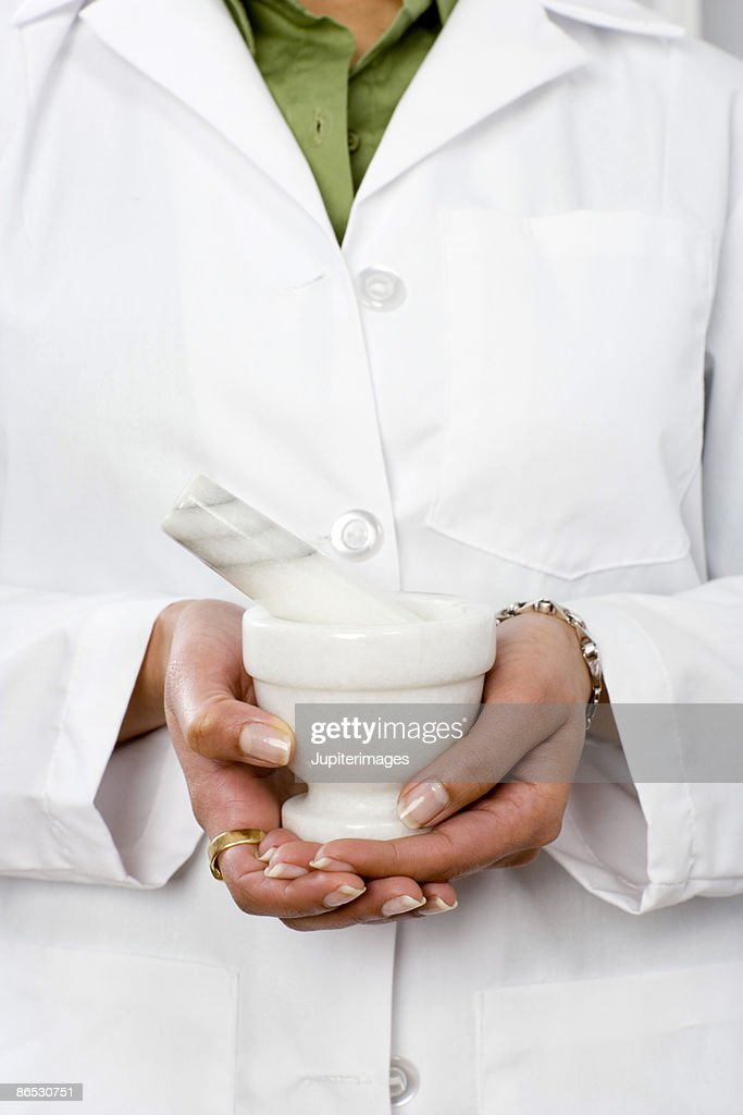 Pharmacist holding mortar and pestle