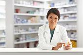Pharmacist Holding Prescription Bottle