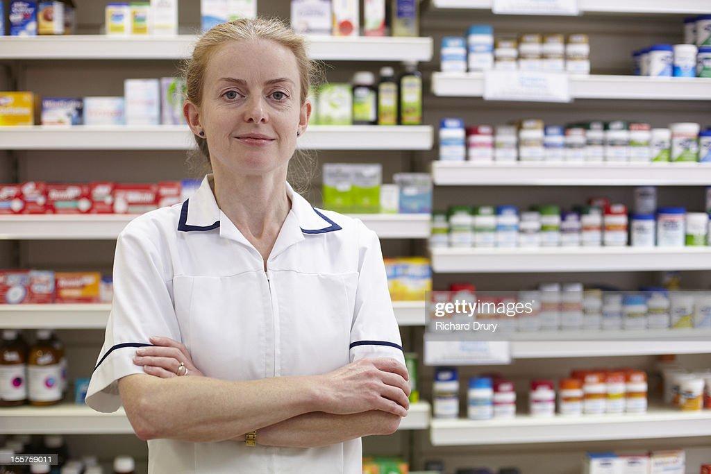 Pharmacist in her shop : Stock Photo