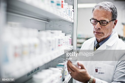 Pharmacist Looking at Pill Bottle