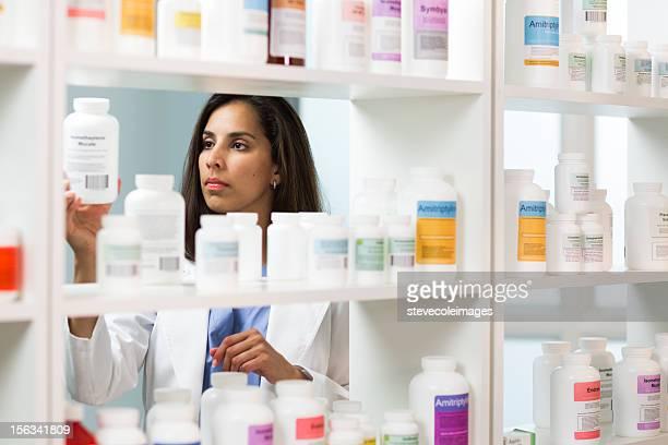 Pharmacist Reading Label