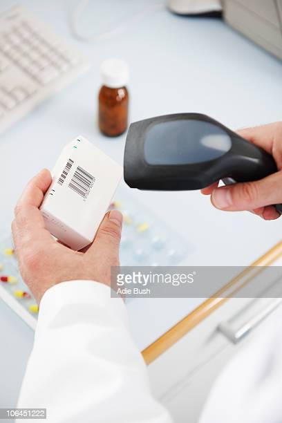 Pharmacist scanning pill box