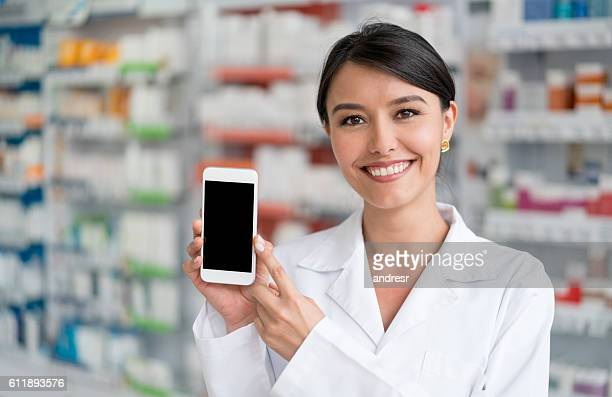 Pharmacist showing cell phone app