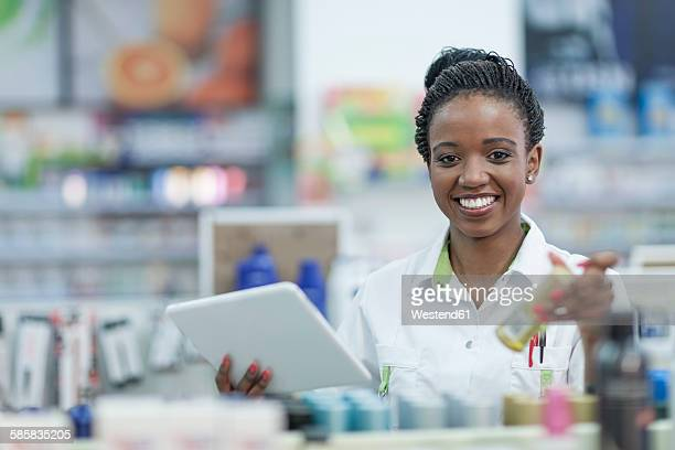 Pharmacist taking stock at drugstore