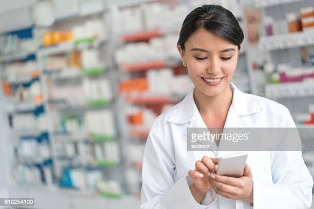 Pharmacist using app on a smart phone