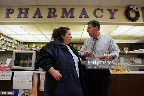 Pharmacist William Hewitt speaks with Rebecca Allen about her Medicare prescription drug benefit program as she buys her drugs at Rosemont Pharmacy...