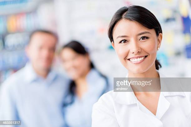 Pharmacist with clients at the drugstore