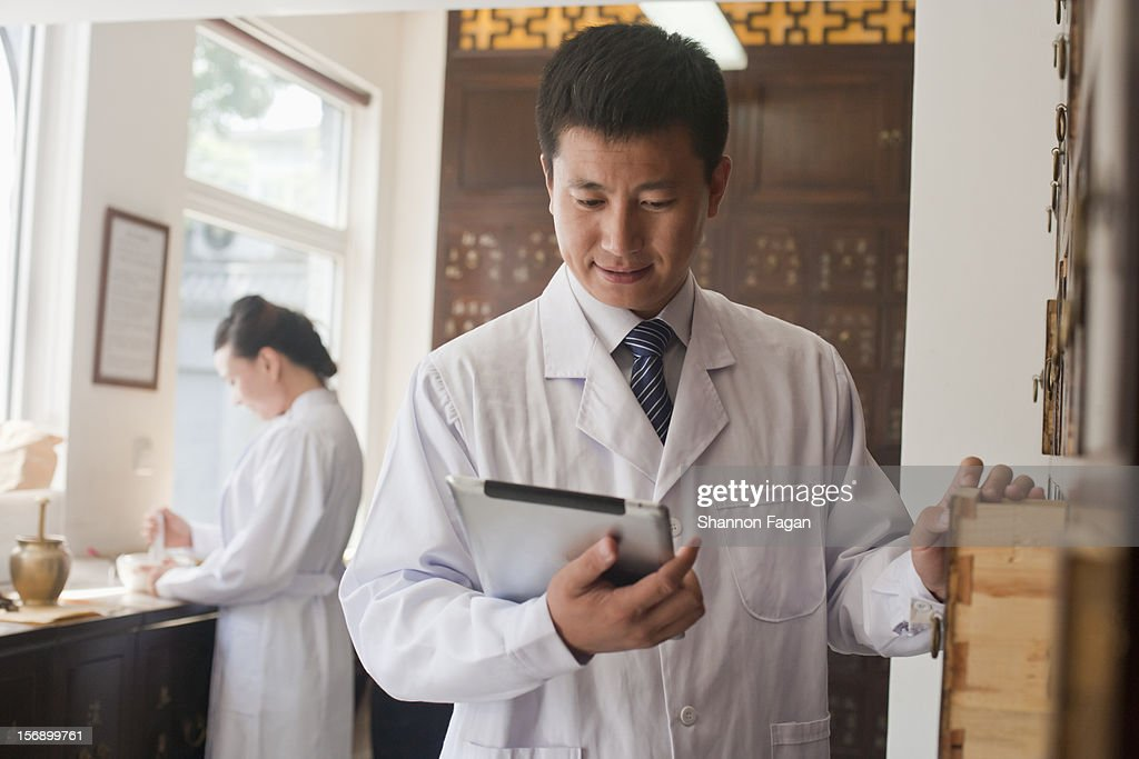 Pharmacist with Digital Tablet : Stock Photo