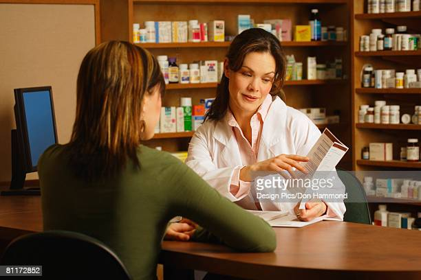 Pharmacist with patient