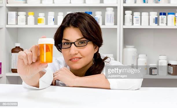 Pharmacist with pill bottle