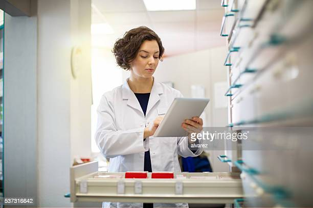 Pharmacist woman working on digital tablet