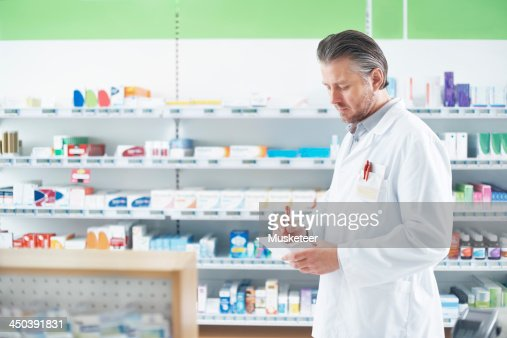 Pharmacist working on a prescription : Stock Photo