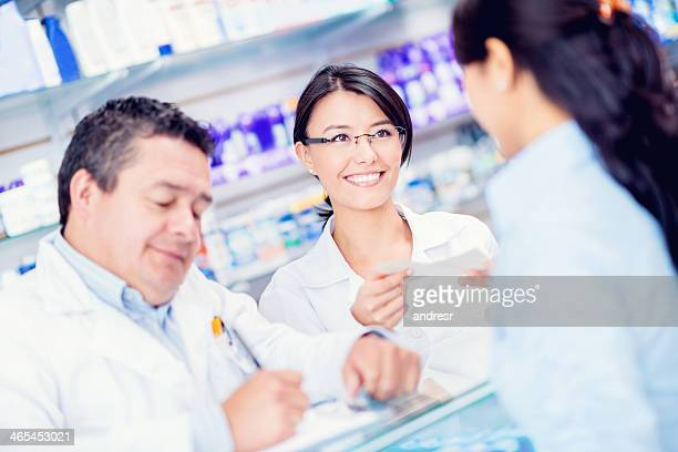 Pharmacists helping patient