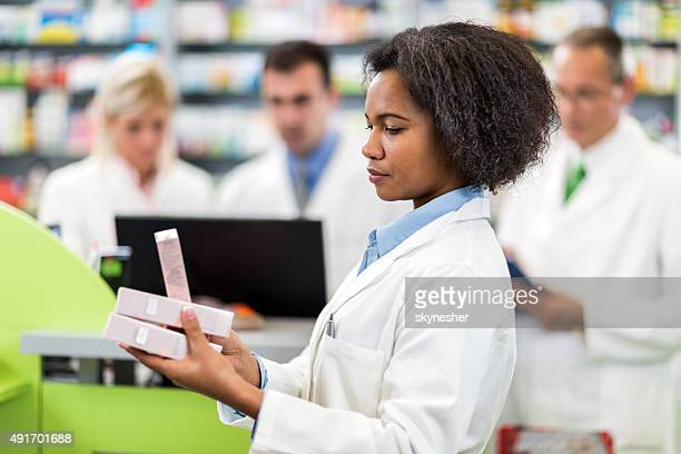 Pharmacists working in a pharmacy.