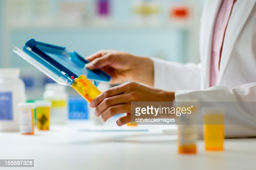 Pharmacy Hands with Pill Counter Tray and Bottle