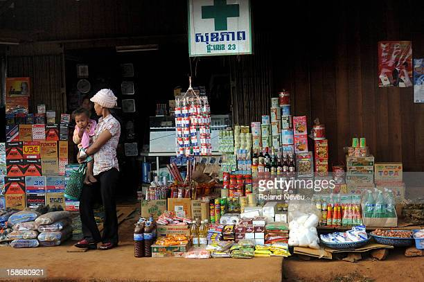A pharmacy in Sen Monorom estern Cambodia doubling as foodstore spilling over the sidewalk