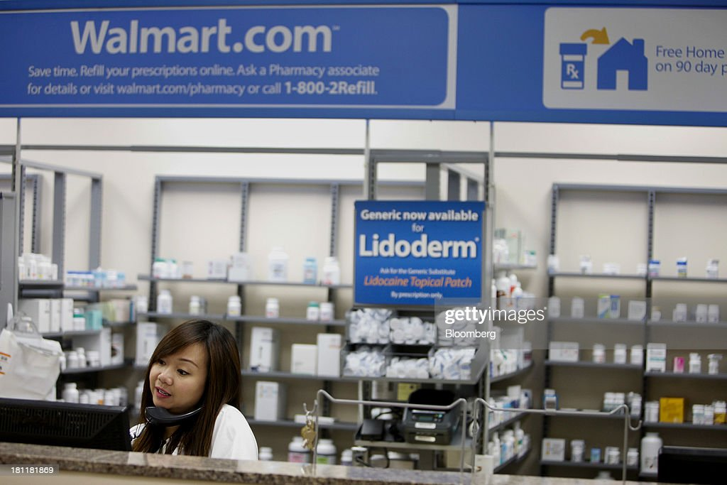 Pharmacy manager Kelly Fong talks on the phone during the grand opening of a Wal-Mart Stores Inc. location in the Chinatown neighborhood of Los Angeles, California, U.S., on Thursday, Sept. 19, 2013. Wal-Mart Stores Inc. will phase out 10 chemicals it sells in favor of safer alternatives and disclose the chemicals contained in four product categories, the company announced Sept. 12. Photographer: Patrick T. Fallon/Bloomberg via Getty Images