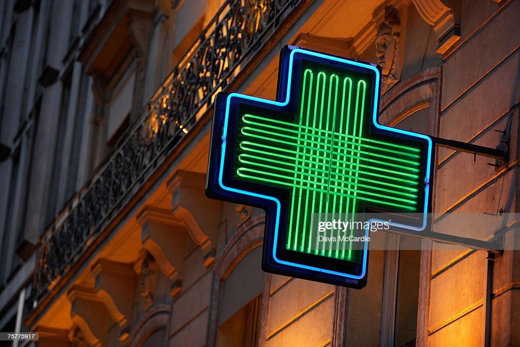 Pharmacy sign in Paris, France : Stock Photo