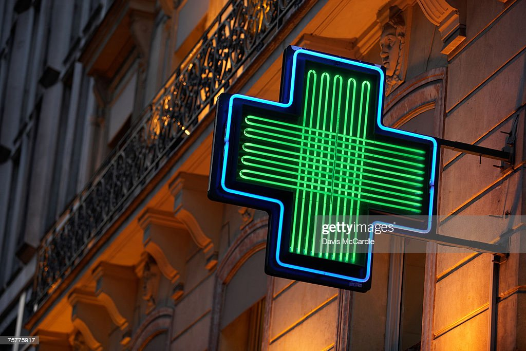 Pharmacy sign in Paris, France
