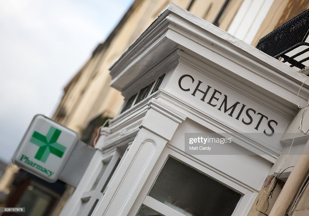 A pharmacy sign is displayed outside a independent chemist shop on February 12, 2016 in Bath, England. One in four high street pharmacies could close as the Government cuts £170 million from the prescription handling fees paid to them.