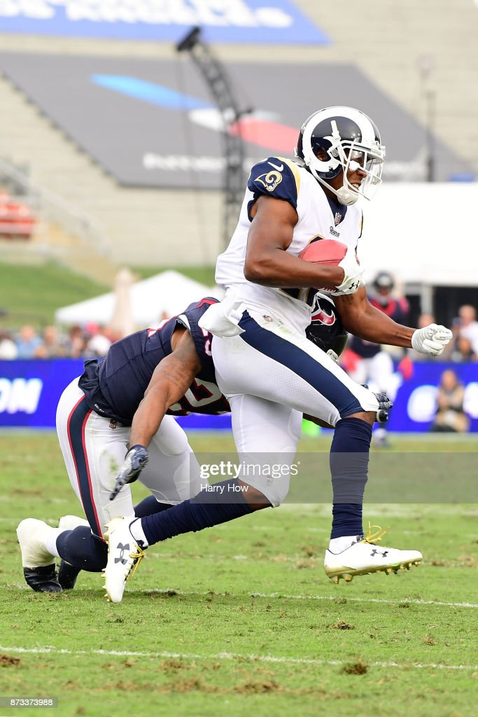 Pharoh Cooper #10 of the Los Angeles Rams attempts to get around Kurtis Drummond #23 of the Houston Texans during the NFL game at the Los Angeles Memorial Coliseum on November 12, 2017 in Los Angeles, California.