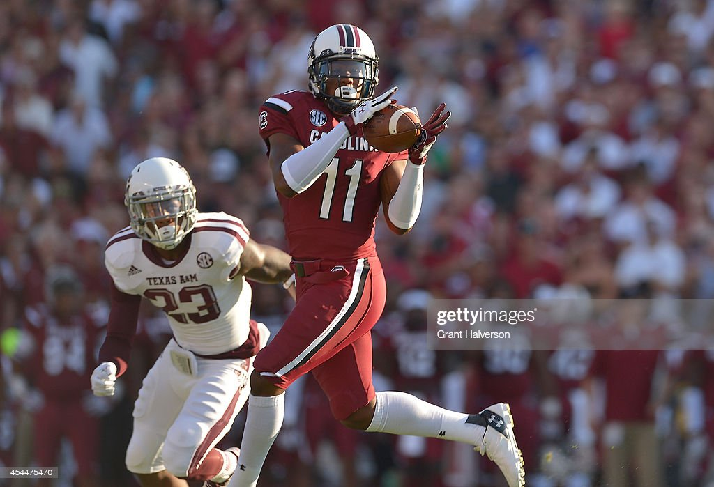 <a gi-track='captionPersonalityLinkClicked' href=/galleries/search?phrase=Pharoh+Cooper&family=editorial&specificpeople=11371015 ng-click='$event.stopPropagation()'>Pharoh Cooper</a> #11 of the South Carolina Gamecocks makes a catch as Armani Watts #23 of the Texas A&M Aggies defends during their game at Williams-Brice Stadium on August 28, 2014 in Columbia, South Carolina.