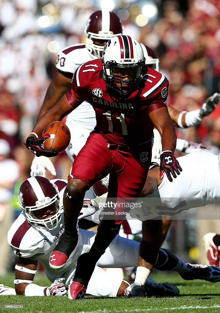 Pharoh Cooper #11 of the South Carolina Gamecocks runs with the ball against the Mississippi State Bulldogs during their game at Williams-Brice Stadium on November 2, 2013 in Columbia, South Carolina.