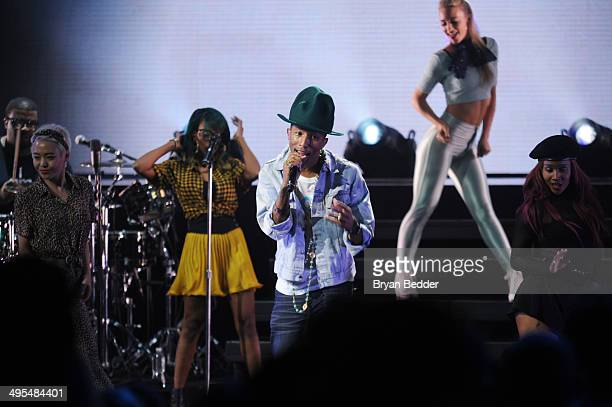 Pharrell performs for the 'American Express Unstaged' music series directed by Spike Lee live streamed from The Apollo Theatre on June 3 2014 in New...