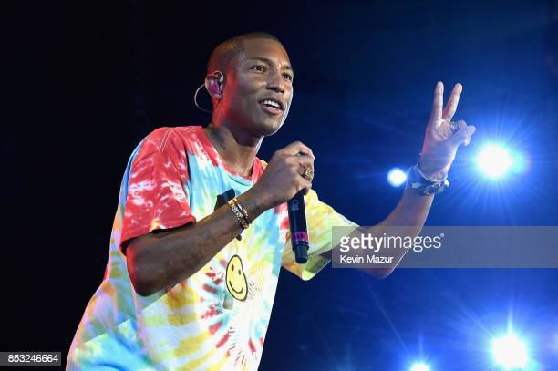 Pharrell performs with The Roots at 'A Concert for Charlottesville' at University of Virginia's Scott Stadium on September 24 2017 in Charlottesville...