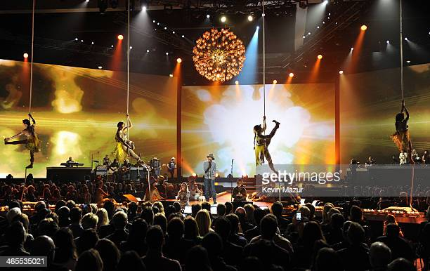 Pharrell Williams and Brad Paisley perform onstage with performers from Cirque du Soleil's 'LOVE' at 'The Night That Changed America A GRAMMY Salute...