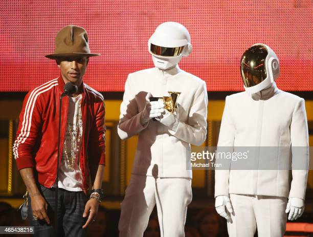 Pharrell Williams and Daft Punk accept an award onstage during the 56th GRAMMY Awards held at Staples Center on January 26 2014 in Los Angeles...