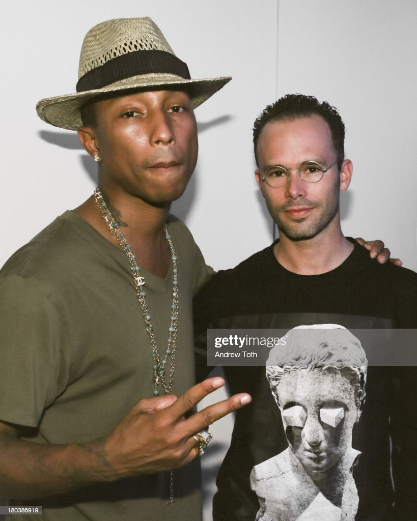 <a gi-track='captionPersonalityLinkClicked' href=/galleries/search?phrase=Pharrell+Williams&family=editorial&specificpeople=161396 ng-click='$event.stopPropagation()'>Pharrell Williams</a> and Daniel Ashram attend the Daniel Ashram And <a gi-track='captionPersonalityLinkClicked' href=/galleries/search?phrase=Pharrell+Williams&family=editorial&specificpeople=161396 ng-click='$event.stopPropagation()'>Pharrell Williams</a> Fashion Week Party at The Standard East Village on September 11, 2013 in New York City.