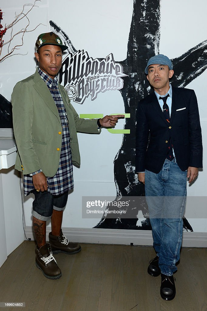 Pharrell Williams and designer Nigo attend the 10th anniversary party of Billionaire Boys Club presented by HTC at Tribeca Canvas on June 4, 2013 in New York City.