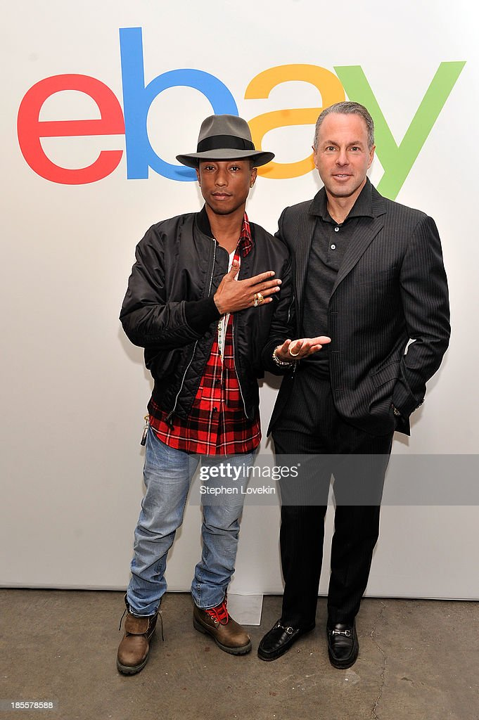 Pharrell Williams and eBay president Devin Wenig attend eBays launch of new features during its Future of Shopping event at Industria Studios on October 22, 2013 in New York City.