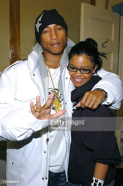 Pharrell Williams and FeFe Dobson during Teen People and Pencil Kick Off the First Annual Music Appreciation Day at a New York Public School at...
