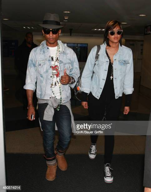 Pharrell Williams and Helen Lasichanh are seen at LAX on June 13 2014 in Los Angeles California